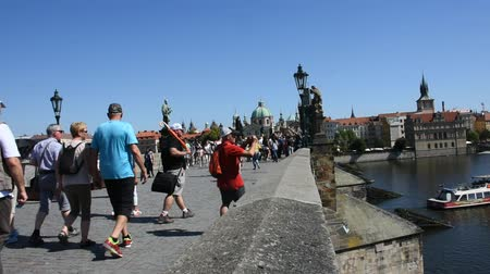 prague bridge : Czechia people and foreigner travelers walking visit and travel on Charles Bridge crossing Vltava river in Prague, Czech Republic Stock Footage