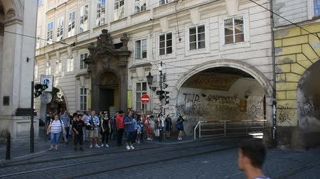 prague bridge : Czechia people and foreigner travelers walking crossing traffic road near Charles Bridge in Prague, Czech Republic Stock Footage