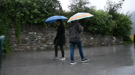 tirol : Traveler thai women mother and daughter  holding umbrella and walking on the road of resort Pfunds city in morning time and raining on September 2, 2017 in Tyrol, Austria