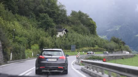 austríaco : Travelers people driving car on the highway road at countryside passed Oetztal tiroler village go to Meran or Merano city of on September 2, 2017 in Tyrol, Austria