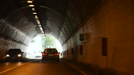 drive through : Italian people and foreigner travelers driving car on the road passed mountain in Car tunnel go to Christmas Market in Meran city on September 2, 2017 in Merano, Italy