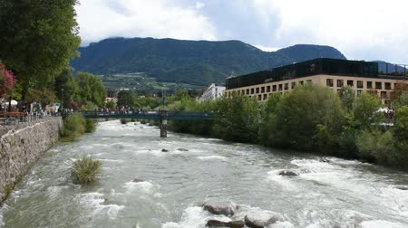 tirol : View cityscape and landscape with Italian people and foreigner travelers walking on the bridge crossover passer river at Meran city on September 2, 2017 in Merano, Italy Stockvideo
