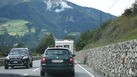 tirol : Travelers people driving car on the highway road at countryside passed Oetztal tiroler village go to Meran or Merano city of on September 2, 2017 in Tyrol, Austria