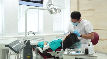 stomatological : Cute young girl is being examined by the dentist Stock Footage