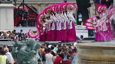 korejština : London, UK - August 9, 2015: Korean ethnic dancers perform, Buchaechum, fan dance, in Korean Festival at Trafalgar Square, spectators present.