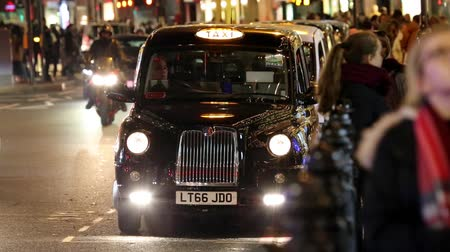 hackney carriage : LONDON - NOV 28 : TX4 Hackney Carriage, also called London Taxi or Black Cab, at Harrods on Nov 28, 2016 in London, UK. TX4 is manufactured by the London Taxis International, LTI.