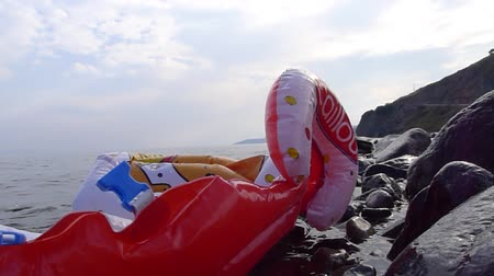 eftalou : LESVOS, GREECE October 05, 2015. Life jackets, rubber rings an pieces of the rubber dinghies discarded on a beach near Molyvos. Eftalou and Skala Sikaminia. Lesvos HAS BEEN a hot spot for refugees. Stock Footage