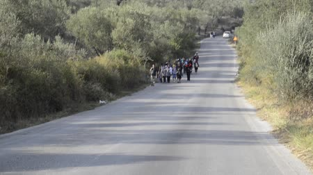 skala : refugees walking on Lesvos