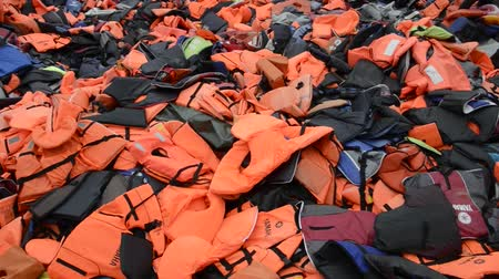eftalou : LESVOS, GREECE March 16, 2016: Mountain of Life Jackets left by refugees. These Syrian, Afghan and African refugees land Their boat at the coast of Lesvos near Molivos, Eftalou
