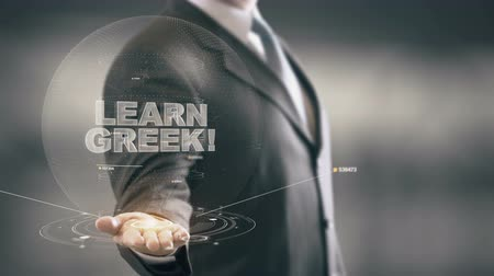 řek : Learn Greek Hologram Concept Businessman Holding in Hand