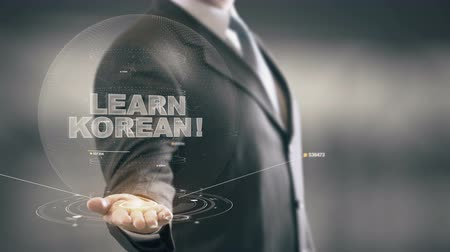 coreano : Learn Korean Hologram Concept Businessman Holding in Hand Stock Footage