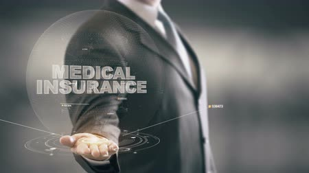 醫療保健 : Medical Insurance Businessman Holding in Hand Hologram technologies