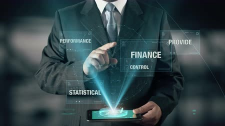 auditing : Businessman with Auditing concept choose Finance from Statistical Provide Control Performance using digital tablet Stock Footage