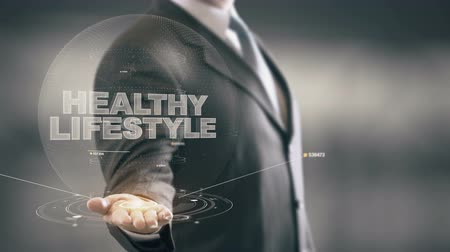 jimnastik : Healthy Lifestyle Businessman Holding in Hand New technologies Stok Video