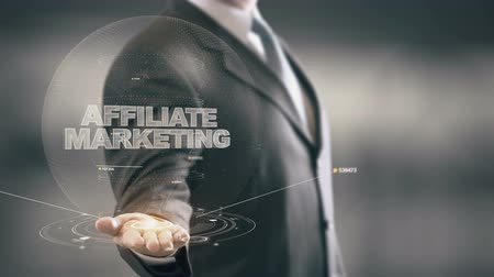 bejelent : Affiliate Marketing with hologram businessman concept Stock mozgókép