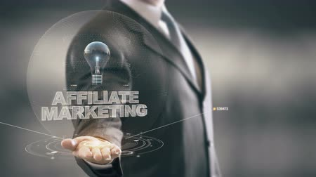 bejelent : Affiliate Marketing with bulb hologram businessman concept