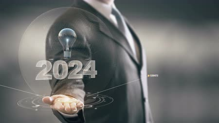 zmiany : 2024 with bulb hologram businessman concept Wideo