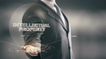 properties : Intellectual Property with hologram businessman concept