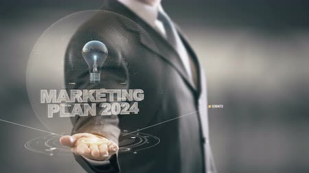 izzók : Marketing Plan 2024 with bulb hologram businessman concept