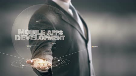 vybírání : Mobile Apps Development with hologram businessman concept