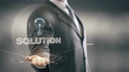 innovator : Solution with bulb hologram businessman concept