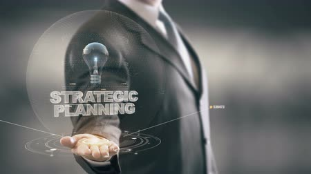 estratégico : Strategic Planning with bulb hologram businessman concept
