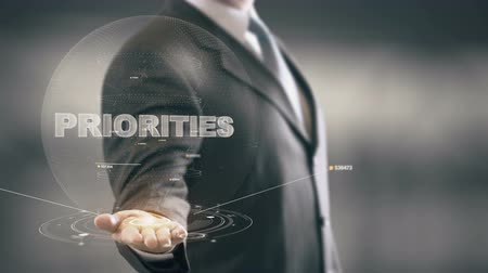 priority : Priorities Businessman Holding in Hand New technologies Stock Footage