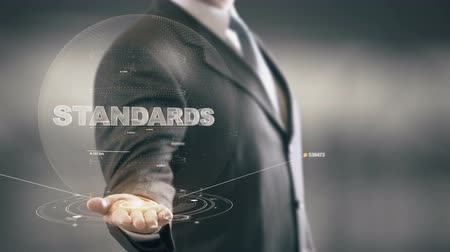 standardization : Standards Businessman Holding in Hand New technologies