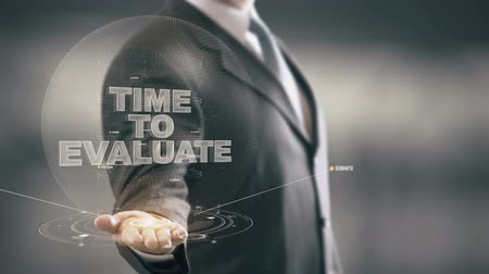 запомнить : Time To Evaluate Businessman Holding in Hand New technologies