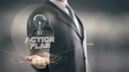 zobrazit : Action Plan with bulb hologram businessman concept
