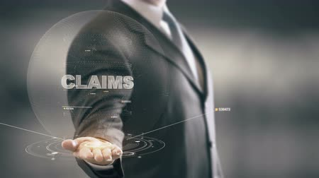 analisar : Claims with hologram businessman concept Stock Footage