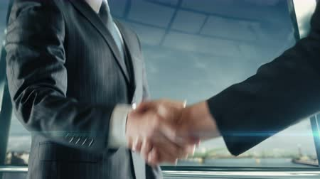 Businessman handshaking at important meeting in Koln Stock Footage