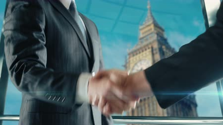 Businessman handshaking at important meeting in London Big Ben
