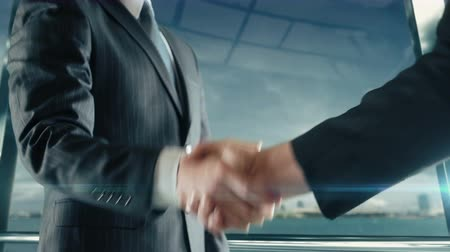 Businessman handshaking at important meeting in San Diego Vídeos