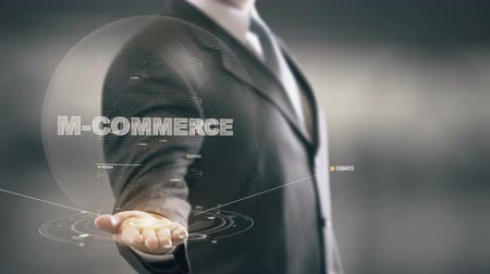 sziám : M-Commerce with hologram businessman concept