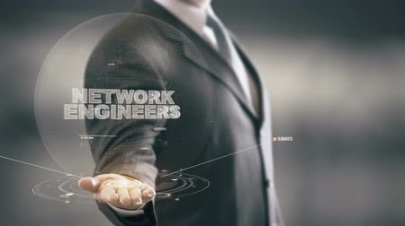 подпись : Network Engineers with hologram businessman concept