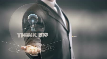 optymizm : Think Big with bulb hologram businessman concept