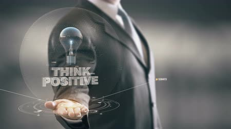 мысль : Think Positive with bulb hologram businessman concept