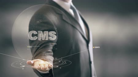ügyintézés : CMS with hologram businessman concept