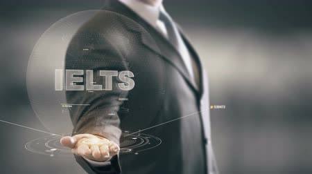 lingua : IELTS con il concetto di businessman ologramma Filmati Stock