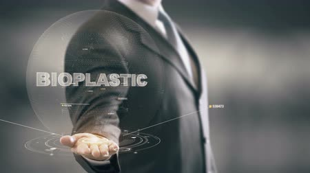молочный : Bioplastic with hologram businessman concept Стоковые видеозаписи