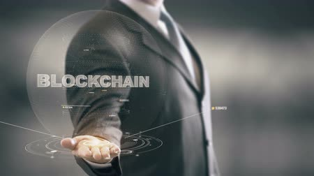 Blockchain with hologram businessman concept