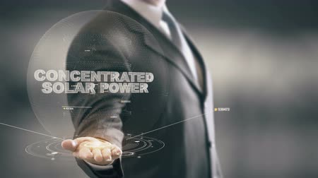 Concentrated Solar Power with hologram businessman concept Stock Footage