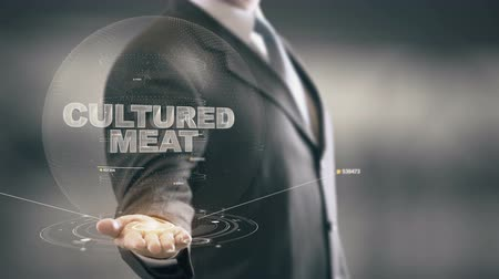 Cultured Meat with hologram businessman concept