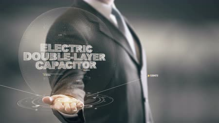 Electric Double-Layer Capacitor with hologram businessman concept Stock Footage
