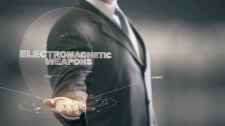 Electromagnetic Weapons with hologram businessman concept
