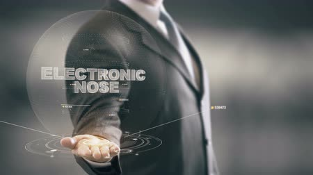 Electronic Nose with hologram businessman concept Stock Footage