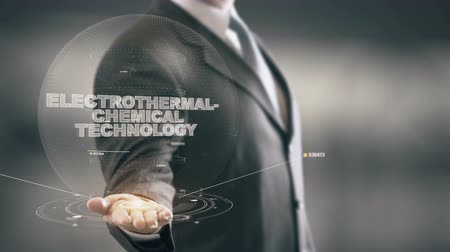 Electrothermal-Chemical Technology with hologram businessman concept Stock Footage