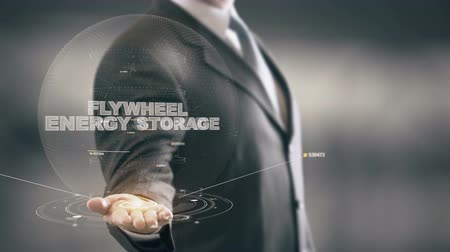 Flywheel Energy Storage with hologram businessman concept Stock Footage