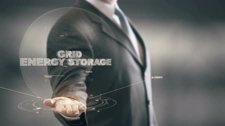 Grid Energy Storage with hologram businessman concept